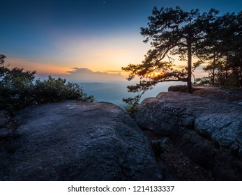 Sunset at Pha Lom Sak cliff in Phu Kradueng in Loei , Thailand