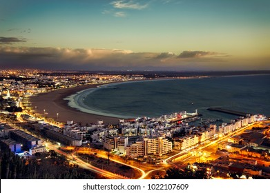 Sunset photo, Agadir, Morocco and the Atlantic-ocean. Light streaks on the roads.
