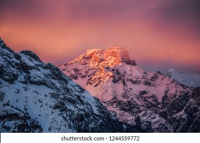 Sunset photo in Dolomites (Alps) at Passo Giau (Giau Pass) Italy. Magnificent mountain sunset. Very cold weather. Orange and blue moutains.