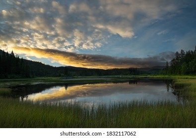 Sunset photo from a forest lake at Hongset,Norway