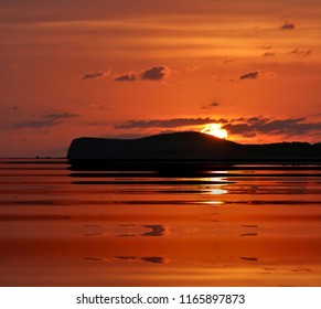 sunset photography in Ibiza,with reflection in the water peace, harmony, tranquility, serenity, meditation, transcendence, relaxation, balance, red sky,