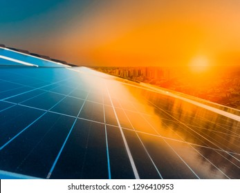 Sunset at photovoltaic solar panel
