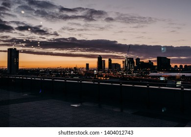 sunset picture over city at night