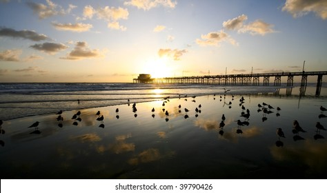 Sunset at the pier with reflection