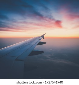 Sunset from plane with view of wing