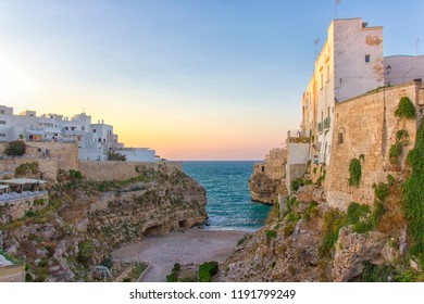 Sunset in Polignano a Mare: beautiful beach among the rocks