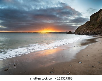 Sunset at Polkerris Beach near St Austel on the south coast of Cornwall