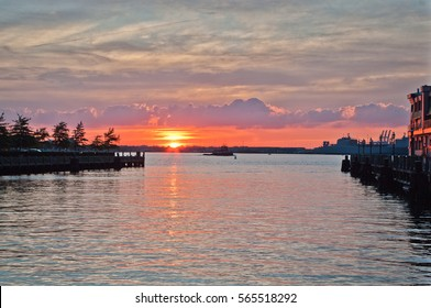 Sunset in port of Norfolk. Virginia. Industrial cranes.