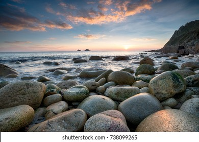Sunset at Porth Nanven beach near Land's End in Cornwall