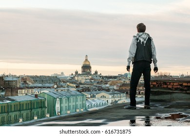 Sunset portrait of man on a roofrop of saint petersburg