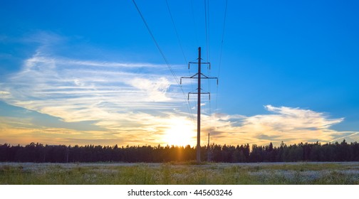 Sunset, power line and forest line. Eastern Europe