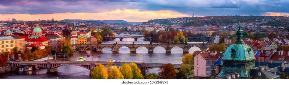 Sunset in Prague panorama, view to the historical bridges, old town and Vltava river from popular view point in the Letna park, autumn landscape in sunset light with amazing cloudy sky, Czech Republic - Shutterstock ID 1392249293