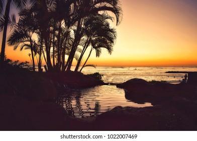 Sunset at Prince Kuahio Beach, Oahu island, Hawaii