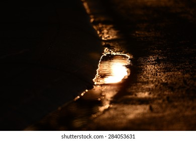 Sunset in the puddle