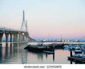 sunset at the Puente de la Constitución, called La Pepa, in the bay of Cádiz, Andalusia. Spain