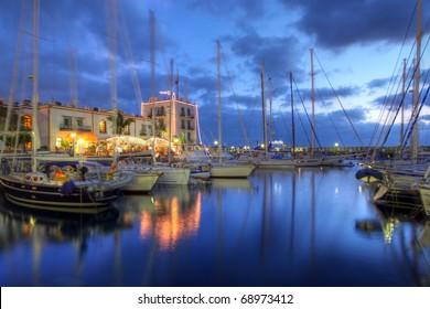 Sunset in Puerto de Mogan, Gran Canaria, Spain (boats in motion blur)
