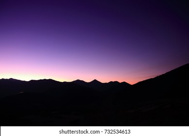 sunset with purple sky in the French Pyrenees. Occitanie in south of France