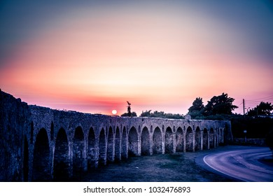 Sunset in Pylos, Peloponnese, Greece, at the ruins of the ancient aqueduct.