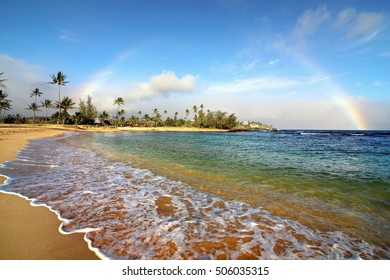 the sunset rainbow on the Poipu beach, island of love, Kauai