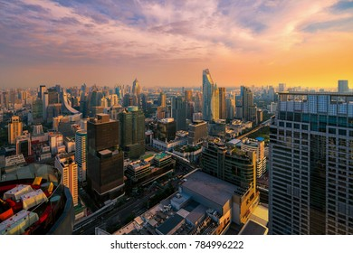 Sunset in Ratchaprasong and Sukhumvit building area in Bangkok city from view point on rooftop bar, bangkok, Thailand