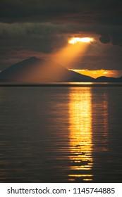 Sunset Ray Of Light Spotlight Over the Ocean