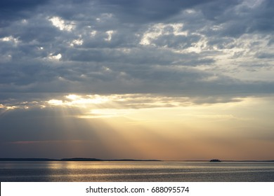 Sunset rays over the ocean landscape background