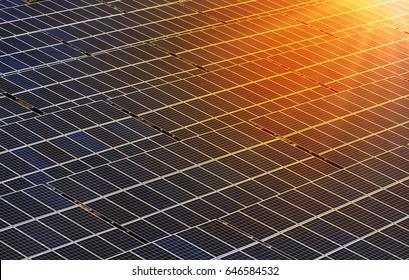 Sunset rays over Solar Panels. Solar Energy concept image.