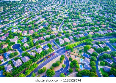 Sunset real estate suburb homes. Community suburbia neighborhood in north Austin in suburb Round Rock , Texas Aerial drone view above new development