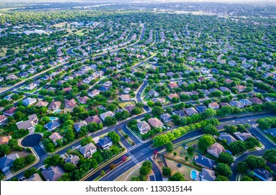 Sunset real estate suburb homes. Community suburbia neighborhood in north Austin in suburb Round Rock , Texas Aerial drone view above new development high above rooftops