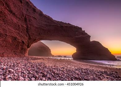 Sunset at red arches of Legzira beach, Sidi Ifni, Souss-Massa-Draa, Morocco.