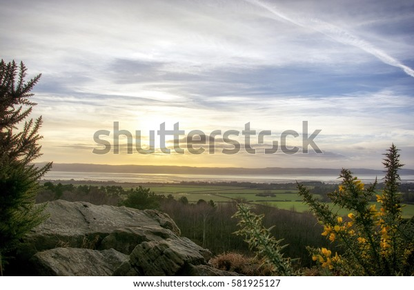 Sunset at Red Rock Heswall Wirral UK looking over the Dee estuary to North Wales
