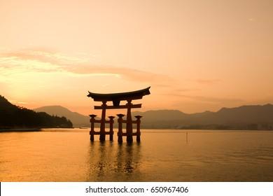 Sunset with Red Torii gate on the river of Itsukushima shrine, Miyajima Island, Japan