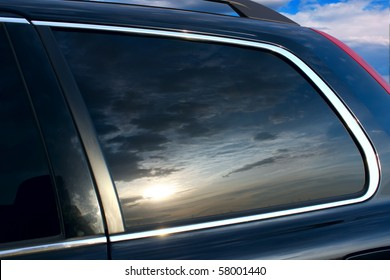 The sunset is reflected in car glass