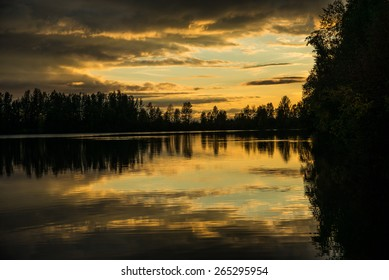 Sunset reflected on lake - Shutterstock ID 265295954