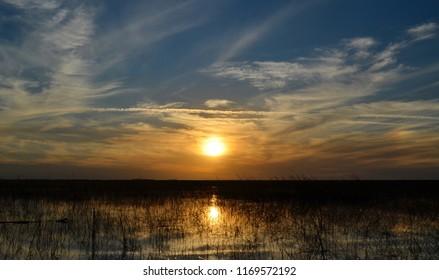 Sunset reflecting in Lake Okeechobee in Florida.