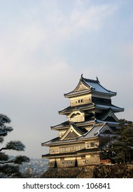 Sunset reflecting off of Matsumoto castle on a winter day, located in Nanago, Japan