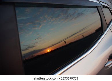 Sunset in the reflection of the car