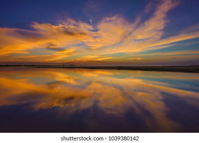 Sunset reflection of Gove Aluminium refinery taking from crocodile beach Northern territory, Queensland, Australia