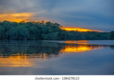 Sunset reflection in a lagoon inside Yasuni national park, Amazon Rainforest, Ecuador.