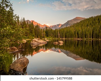 Sunset reflection of mountains and rocks at Bear Lake in Rocky Mountain National Park, Colorado