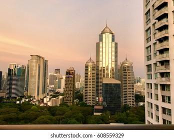 Sunset reflection on glass panels on cityscape building