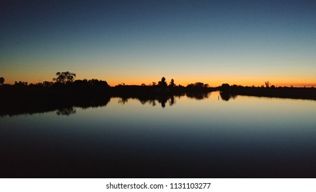 Sunset reflection on a lake, specifically the Stockton Delta in California