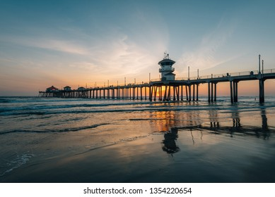 Sunset reflections and the pier in Huntington Beach, Orange County, California