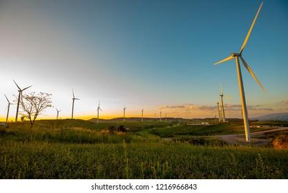 Sunset renewable energy concept, wind turbines