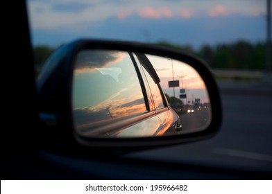 sunset in the rerview mirror