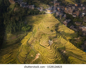 Sunset in the rice terraces of Ping An village, Longheng county, Guangxi Province, China.