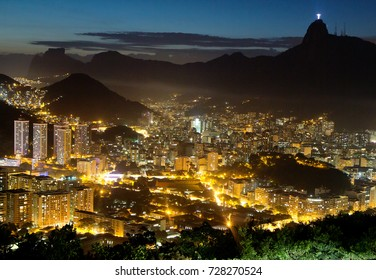 Sunset in Rio de Janeiro. View from mount Sugarloaf.  Beautiful purple sunset adorned the sky of the Brazilian city of Rio de Janeiro.