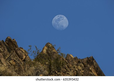 Sunset and a rising moon over Phoenix Mountain Preserve