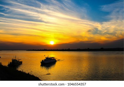 Sunset river boat silhouette landscape