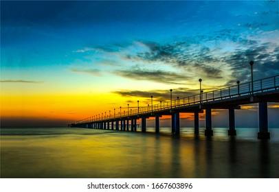 Sunset river bridge pier scene